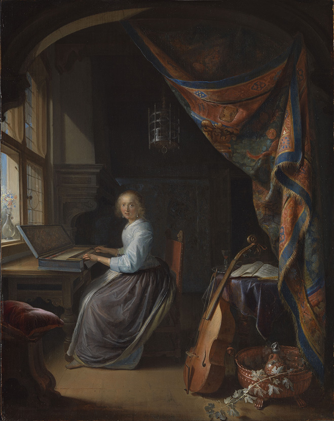 woman playing a clavichord